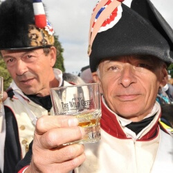 Two battle re-enactors raising a glass of Wild Geese to the strong Irish-Franco relationship that still exists today